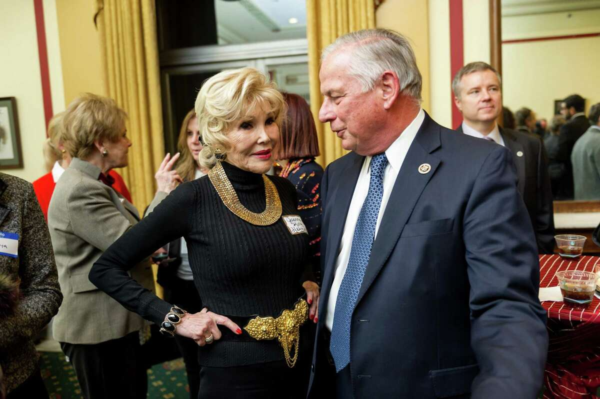 Socialite Joanne Herring, with Rep. Gene Green Wednesday, may receive Congress' top civilian honor.