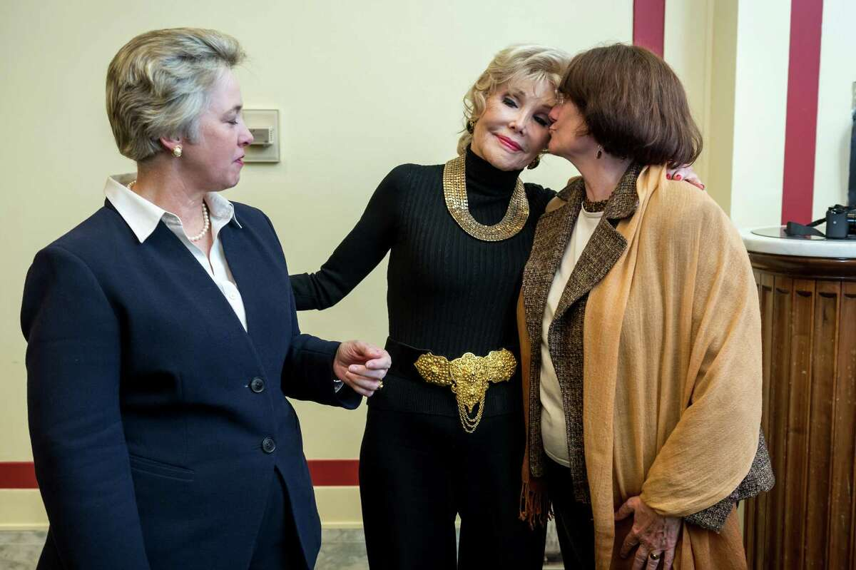 Joanne Herring, center, with first lady Kathy Hubbard, right, and Mayor Annise Parker.