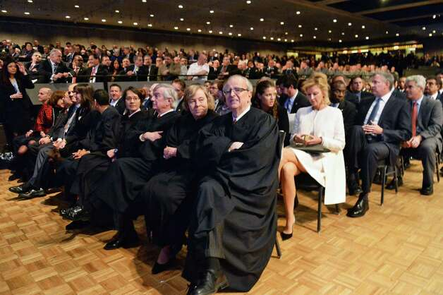 NYS Court of Appeals Chief Judge Jonathan Lippman, center, awaits the start of Gov. Cuomo's State of the State address and budget proposal Wednesday, Jan. 21, 2015, at the Empire State Plaza Convention Center in Albany, N.Y. (John Carl D'Annibale / Times Union) Photo: John Carl D'Annibale / 00030240B