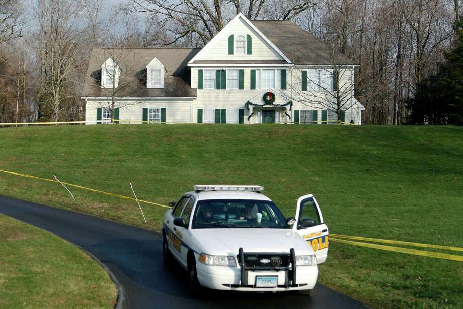 FILE - In this Dec. 18, 2012 file photo a police cruiser sits in the driveway of the home of Nancy Lanza, in Newtown, Conn. The Newtown Legislative Council is voting Wednesday, Jan. 21, 2015 on a proposal recommended by the board of selectmen to raze the 3,100-square-foot home and keep the land as open space. The Colonial-style home where Newtown school shooter Adam Lanza lived with his mother has been transferred to the town in a deal with a bank. Nancy Lanza was killed there by her son before he forced his way into Sandy Hook Elementary School, Dec. 14, 2012, in Newtown, where he killed 20 first-graders and six educators. (AP Photo/Jason DeCrow, File) ORG XMIT: BX401 Photo: Jason DeCrow / FR103966 AP
