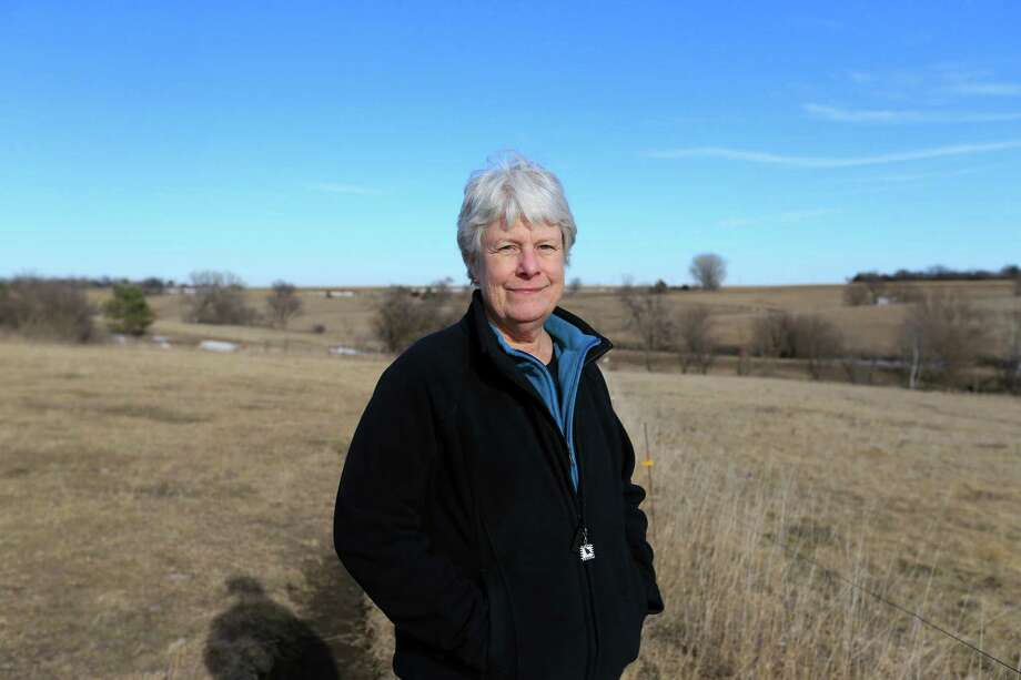 FILE - In this Jan. 16, 2015 file photo, Susan Dunavan, who opposes the Keystone XL pipeline, poses for a photo on her property through which the pipeline is planned to be built, in York, Neb. Officials with TransCanada said Tuesday, Jan. 20, 2015,  they've filed paperwork in nine counties to acquire access to land that's needed for the construction and operation of the pipeline. The route still faces challenges as opponents have filed lawsuits to try to prevent the Calgary, Alberta-based company from using eminent domain and to overturn the state law that allowed ex-Gov. Dave Heineman to approve the route. (AP Photo/Nati Harnik, File) ORG XMIT: NENH105 Photo: Nati Harnik / AP