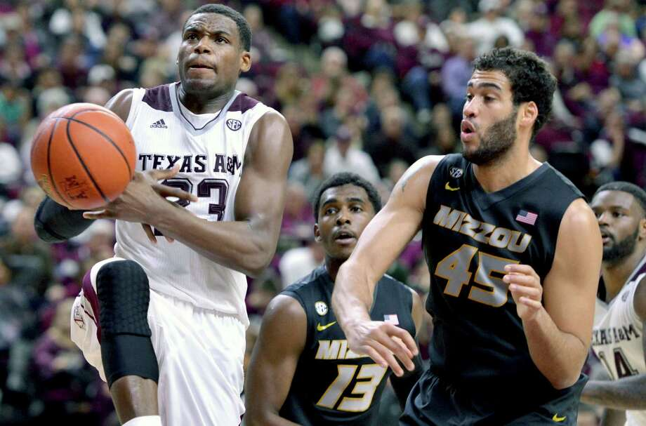 Texas A&M's Danuel House (23) has the ball knocked out of his hands by Missouri forward Keanau Post (45) during an NCAA men's basketball game, Wednesday, Jan. 21, 2015 at Reed Arena in College Station Texas. Photo: Sam Craft /Associated Press / College Station Eagle