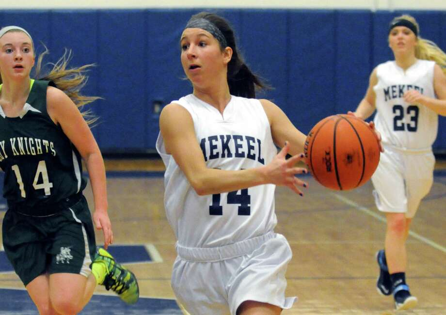 Mekeel Christian Academy's senior guard Macie Holmes drives to the basket during their girl's high school basketball game against Middleburgh Lady Knights on Wednesday Jan. 21, 2015 in Scotia N.Y. (Michael P. Farrell/Times Union) Photo: Michael P. Farrell / 00030267A
