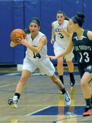 Mekeel Christian Academy's senior guard Macie Holmes looks to pass during their girl's high school basketball game against Middleburgh Lady Knights on Wednesday Jan. 21, 2015 in Scotia N.Y. (Michael P. Farrell/Times Union) Photo: Michael P. Farrell / 00030267A