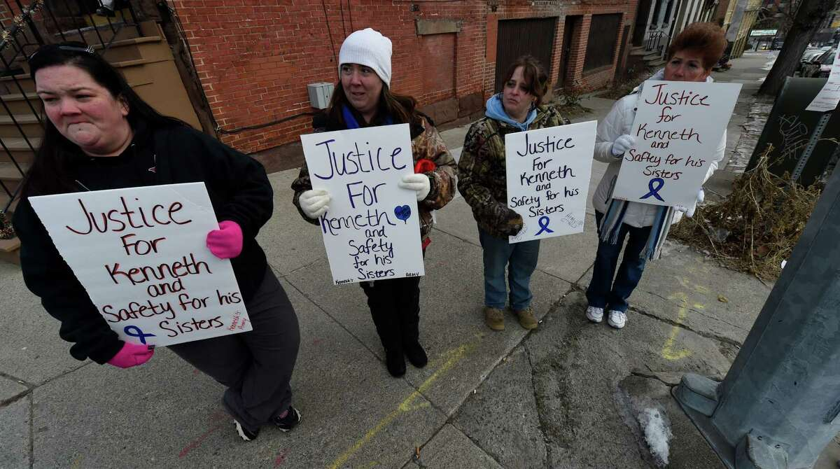 Demonstrators line up across the street from the Albany County Family Court building Wednesday morning, Jan. 21, 2015 in Albany, N.Y. The demonstrators; Heather Bier, Dawn Gibson, Gina Klein-Colon and Joyce Sousa were showing their advocacy for children involved in the Kenneth White case. (Skip Dickstein/Times Union)