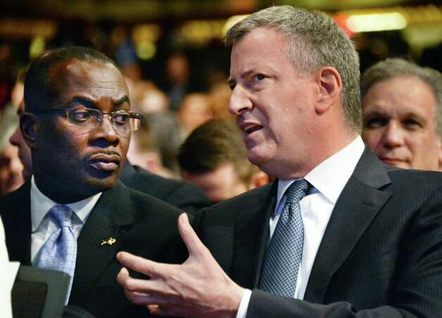 Buffalo Mayor Byron Brown, left, and New York Mayor Bill de Blasio, talk before the start of the State of the State address and budget proposal Wednesday Jan. 21, 2015, at the Empire State Plaza Convention Center in Albany, N.Y. (John Carl D'Annibale / Times Union) Photo: John Carl D'Annibale / 00030240B