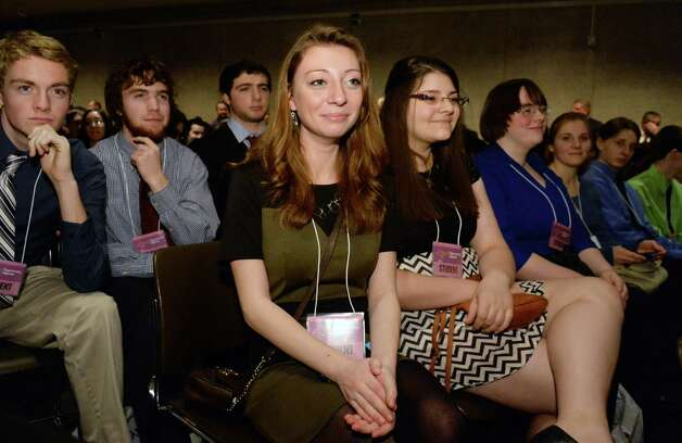 Jessica Ball, center, and class mates from Ballston Spa High were among 300 students from around the state invited to NYS Gov. Andrew Cuomo's State of the State address and budget proposal Wednesday, Jan. 21, 2015, at the Empire State Plaza Convention Center in Albany, N.Y. (John Carl D'Annibale / Times Union) Photo: John Carl D'Annibale / 00030240B