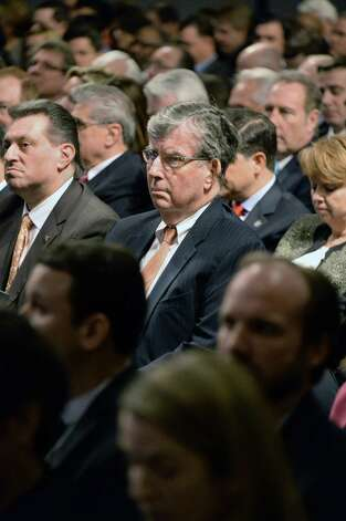 Sen. Neil Breslin, center listens to Gov. Cuomo's State of the State address and budget proposal at the Empire State Plaza Convention Center Wednesday Jan. 21, 2015, in Albany, N.Y.  (John Carl D'Annibale / Times Union) Photo: John Carl D'Annibale / 00030240B