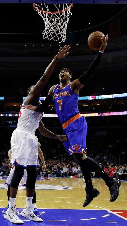 New York Knicks' Carmelo Anthony, right, goes up for a shot against Philadelphia 76ers' Henry Sims during the first half of an NBA basketball game, Wednesday, Jan. 21, 2015, in Philadelphia. (AP Photo/Matt Slocum) ORG XMIT: PXC104 Photo: Matt Slocum / AP