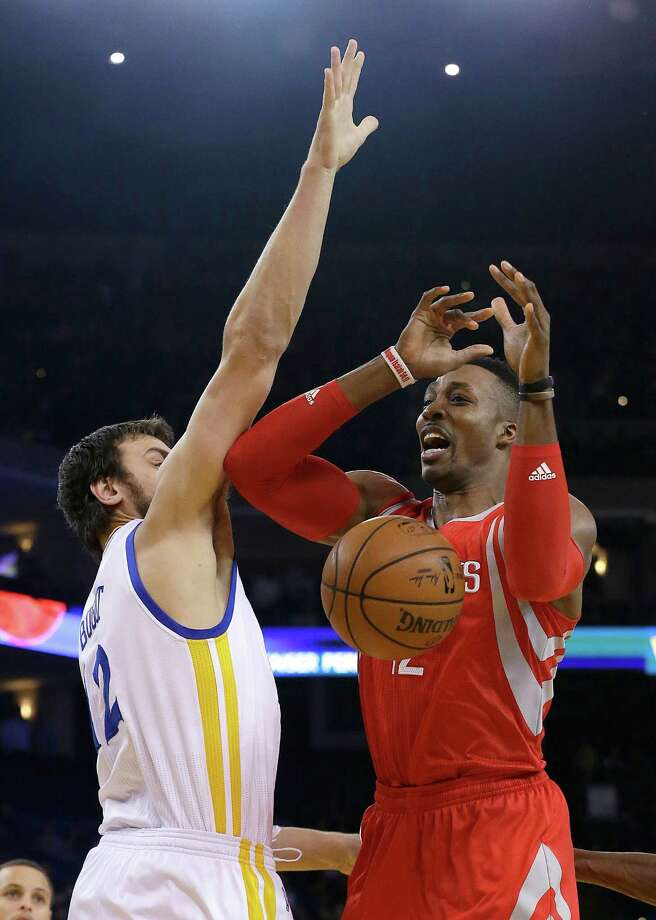 Rockets center Dwight Howard, right, loses the ball as the Warriors' Andrew Bogut defends during the team's Jan. 21 meeting in Oakland. Photo: Jeff Chiu / Jeff Chiu / Associated Press / AP
