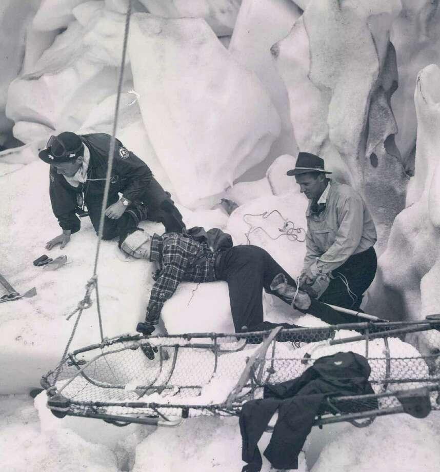 A Glacier Rescue is practiced by, from left, Kurt Beam, Jim Slauson and Dee Molenaar. They are in a crevasse on Nisqually Glacier, Mount Rainier. Photo: Seattle Times/JR Partners, Getty Images / 2014 The Seattle Times