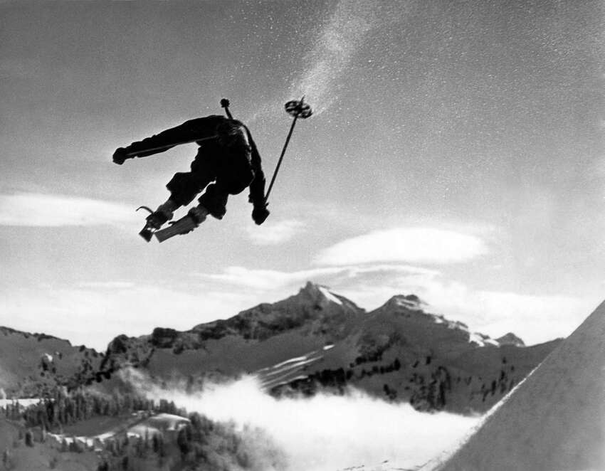 Hans Grage, an Olympic hopeful, appears to be jumping right over Mt. Rainier in this dramatic photo, Washington, January 5, 1935.