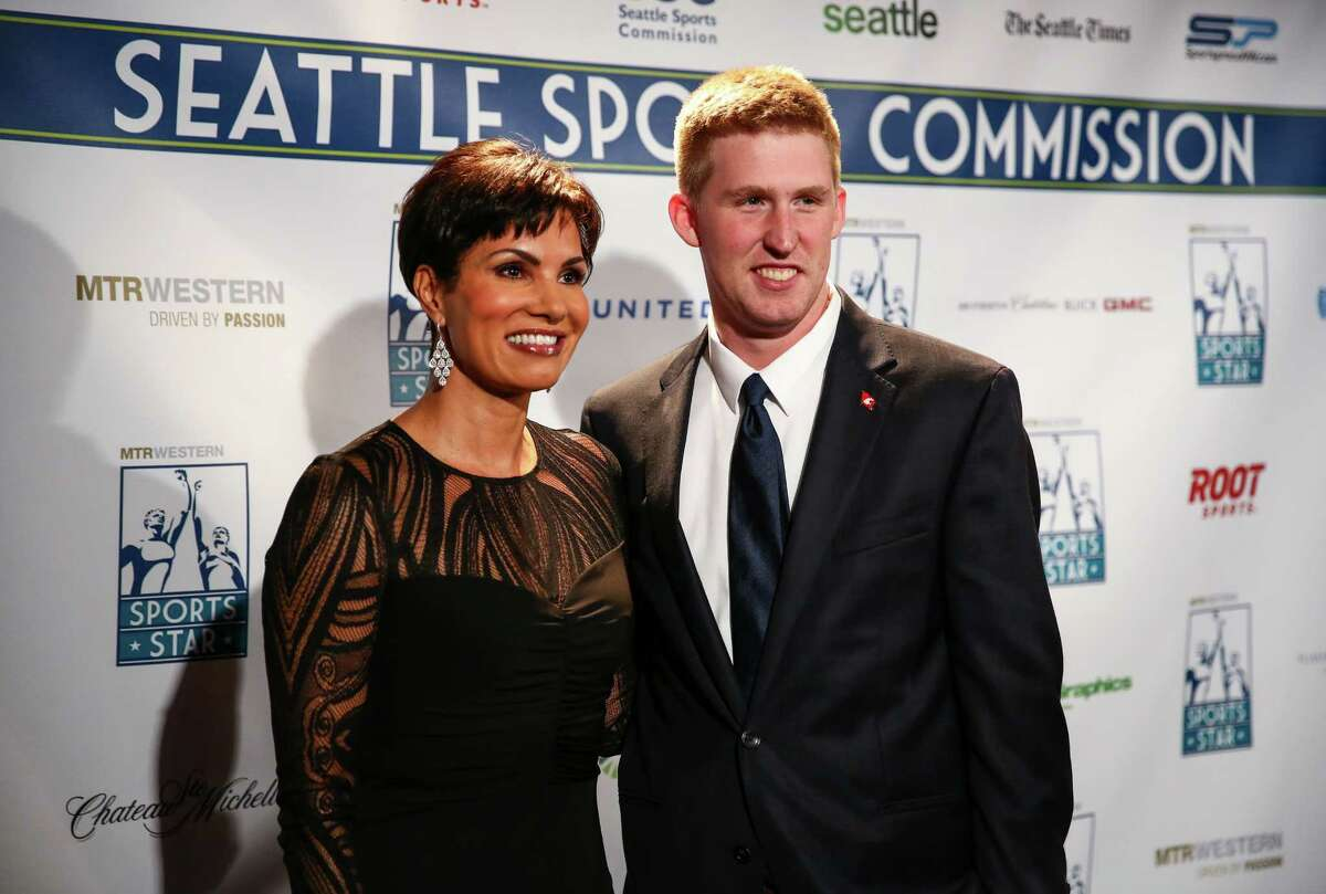 Television newscaster Cindy Brunson poses for a photo with Washington State University quarterback Connor Halliday during the annual Sports Star of the Year Awards at Benaroya Hall on Wednesday.