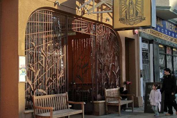The exterior of Gracias Madre features custom grillwork that looks like stalks of corn.