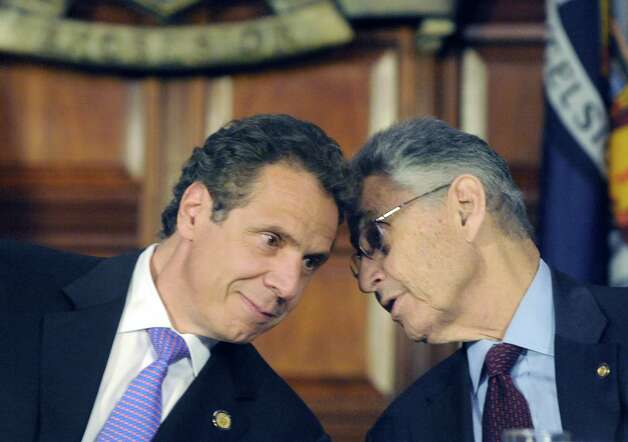 Governor Andrew M. Cuomo, left, and Assembly Speaker Sheldon Silver have a private talk during an announcement of a agreement on a medical marijuana deal at the Capitol on Thursday June 19, 2014 in Albany, N.Y.  (Michael P. Farrell/Times Union) ORG XMIT: MER2014061916535658 Photo: Michael P. Farrell / 00027435A