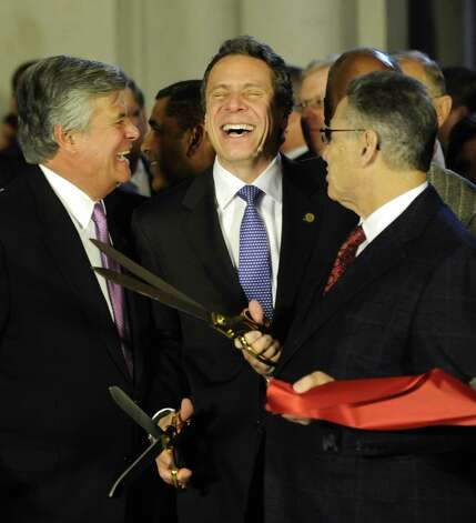 Senate Majority Dean Skelos, left, Governor Andrew Cuomo, center and Assembly Speaker Sheldon Silver, right try to figure out who cut the ceremonial ribbon on the renovated portions of the Capitol first  before going to the Convention Center in the Empire State Plaza  in Albany, N.Y. to hear The Governor's Annual State of the State message Jan. 4, 2011.   (Skip Dickstein / Times Union) ORG XMIT: MER2015012208012629 Photo: SKIP DICKSTEIN / 2011