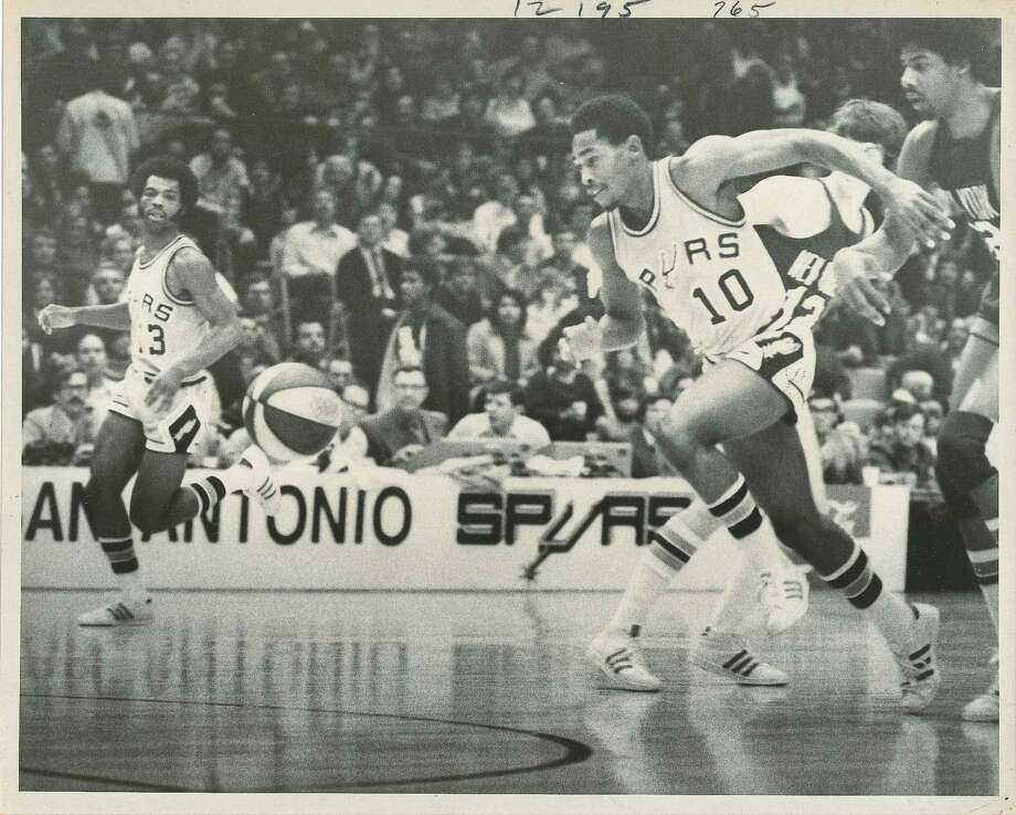 In 1973, a tradition began in the Alamo City: the San Antonio Spurs. The franchise moved here from Dallas, after the team (then named the Chaparrals) suffered continuous struggles to attract fans and have a winning season. These photos are from the Spurs' debut season in their new home, the HemisFair Arena. Photo: San Antonio Express-News File Photo