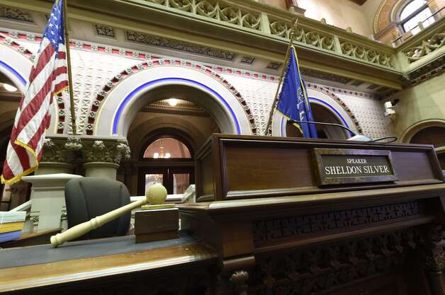 Speaker Sheldon Silver's podium sits vacant in the Capitol's Assembly chamber on Thursday. The 70-year-old Democrat was in Manhattan where he was to face federal corruption charges. (Skip Dickstein / Times Union)