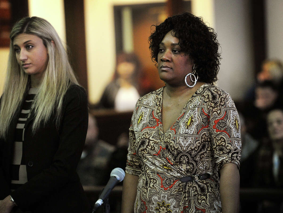 Patricia Daniels, right, stands with her lawyer as she is arraigned on charges of second-degree manslaughter, risk of injury to a minor, and criminal evading responsibility at Superior Court in Bridgeport, Conn. on Thursday, January 22, 2015.