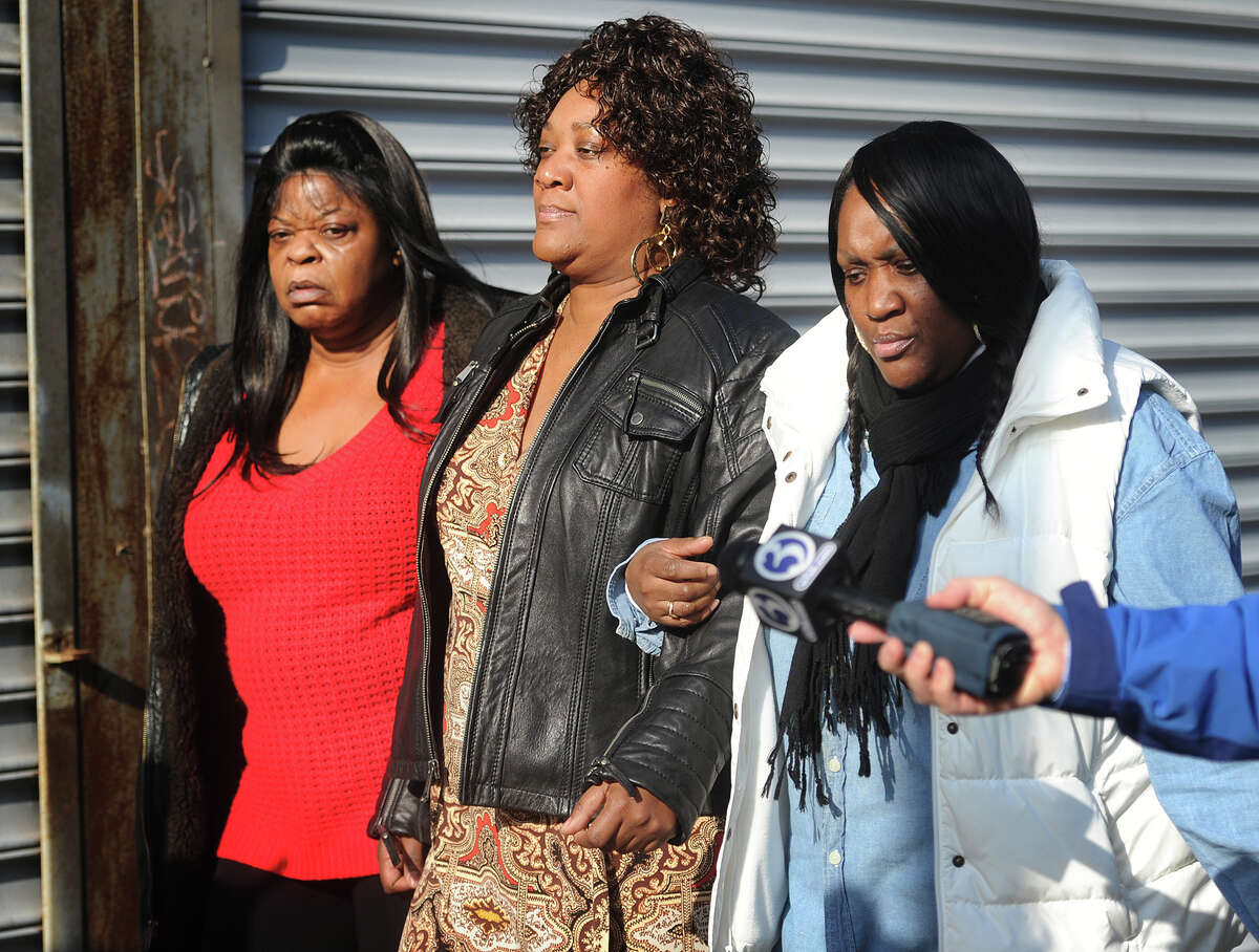 Patricia Daniels, center, exits Superior Cout in Bridgeport, Conn. following her arraignment on charges of second-degree manslaughter, risk of injury to a minor, and criminal evading responsibility on Thursday, January 22, 2015.