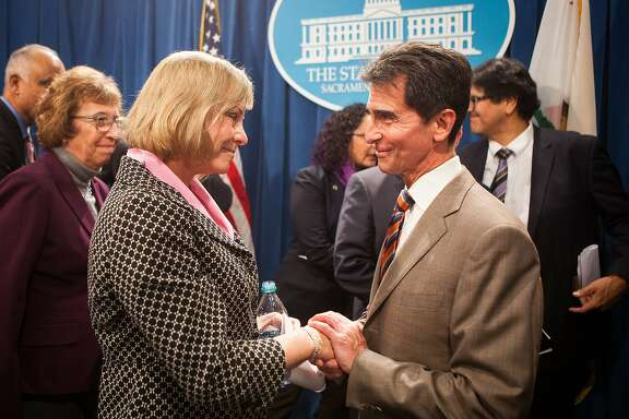 """Brittany Maynard's mother, Debbie Ziegler, left, is thanked by Senator Mark Leno, right, after a press conference introducing SB 128, """"The End-of-Life Options Act"""" at the State Capitol in Sacramento, California, January 21, 2015."""