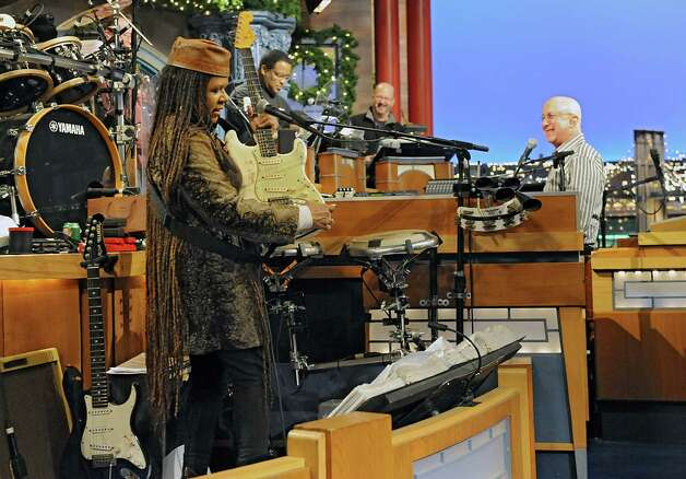 Felicia Collins, left, lead guitarist with the CBS Orchestra with Paul Shaffer, right, plugs in for rehearsal on the Late Show with David Letterman on Wednesday Dec. 17, 2014 in New York, N.Y. Collins grew up in Albany, graduated from Bishop Maginn High School and has had the Letterman gig since 1993. (Lori Van Buren / Times Union) Photo: Lori Van Buren / 00029836A