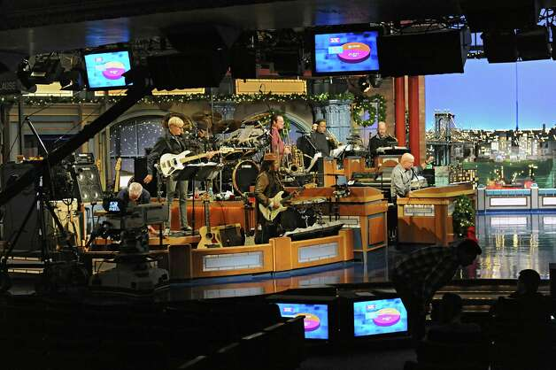 Felicia Collins, center, lead guitarist with the CBS Orchestra with Paul Shaffer, plays her guitar during rehearsal for the Late Show with David Letterman on Wednesday Dec. 17, 2014 in New York, N.Y. Collins grew up in Albany, graduated from Bishop Maginn High School and has had the Letterman gig since 1993. (Lori Van Buren / Times Union) Photo: Lori Van Buren / 00029836A