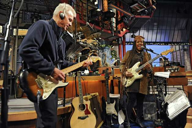 Guitarist Sid McGinnis and Felicia Collins, lead guitarist with the CBS Orchestra with Paul Shaffer, rehearse for the Late Show with David Letterman on Wednesday Dec. 17, 2014 in New York, N.Y. Collins grew up in Albany, graduated from Bishop Maginn High School and has had the Letterman gig since 1993. (Lori Van Buren / Times Union) Photo: Lori Van Buren / 00029836A