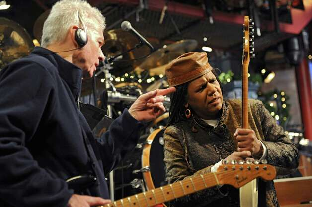 Guitarist Sid McGinnis gives Felicia Collins, lead guitarist with the CBS Orchestra with Paul Shaffer, a tip on fixing the missing position marker (dot) on the fingerboard of her guitar during rehearsal for the Late Show with David Letterman on Wednesday Dec. 17, 2014 in New York, N.Y. Collins grew up in Albany, graduated from Bishop Maginn High School and has had the Letterman gig since 1993. (Lori Van Buren / Times Union) Photo: Lori Van Buren / 00029836A