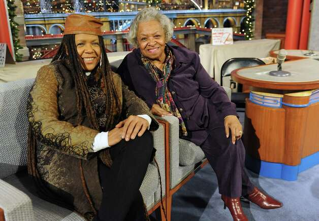 Felicia Collins, lead guitarist with the CBS Orchestra with Paul Shaffer, sits in the guest chairs on stage with her mother Lorraine Collins after a taping of the Late Show with David Letterman on Wednesday Dec. 17, 2014 in New York, N.Y. Collins grew up in Albany, graduated from Bishop Maginn High School and has had the Letterman gig since 1993. (Lori Van Buren / Times Union) Photo: Lori Van Buren / 00029836A