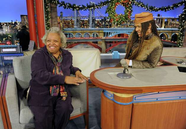 Felicia Collins, lead guitarist with the CBS Orchestra with Paul Shaffer, sits behind David Letterman's desk on stage and chats with her mother Lorraine Collins after a taping of the Late Show with David Letterman on Wednesday Dec. 17, 2014 in New York, N.Y. Collins grew up in Albany, graduated from Bishop Maginn High School and has had the Letterman gig since 1993. (Lori Van Buren / Times Union) Photo: Lori Van Buren / 00029836A