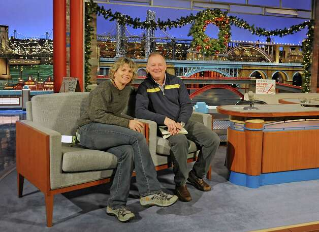 Photographer Lori Van Buren and reporter Paul Grondahl sit in the guest chairs next to David Letterman's desk on stage after a taping of the Late Show with David Letterman on Wednesday Dec. 17, 2014 in New York, N.Y. The journalist were covering a story about Felicia Collins,  lead guitarist with the CBS Orchestra with Paul Shaffer, who grew up in Albany, graduated from Bishop Maginn High School and has had the Letterman gig since 1993. (Lori Van Buren / Times Union) Photo: Lori Van Buren / 00029836A