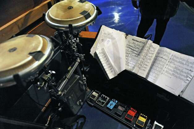 Binders of sheet music, congas and foot pedals used by Felicia Collins, lead guitarist with the CBS Orchestra with Paul Shaffer, for the Late Show with David Letterman on Wednesday Dec. 17, 2014 in New York, N.Y. Collins grew up in Albany, graduated from Bishop Maginn High School and has had the Letterman gig since 1993. (Lori Van Buren / Times Union) Photo: Lori Van Buren / 00029836A