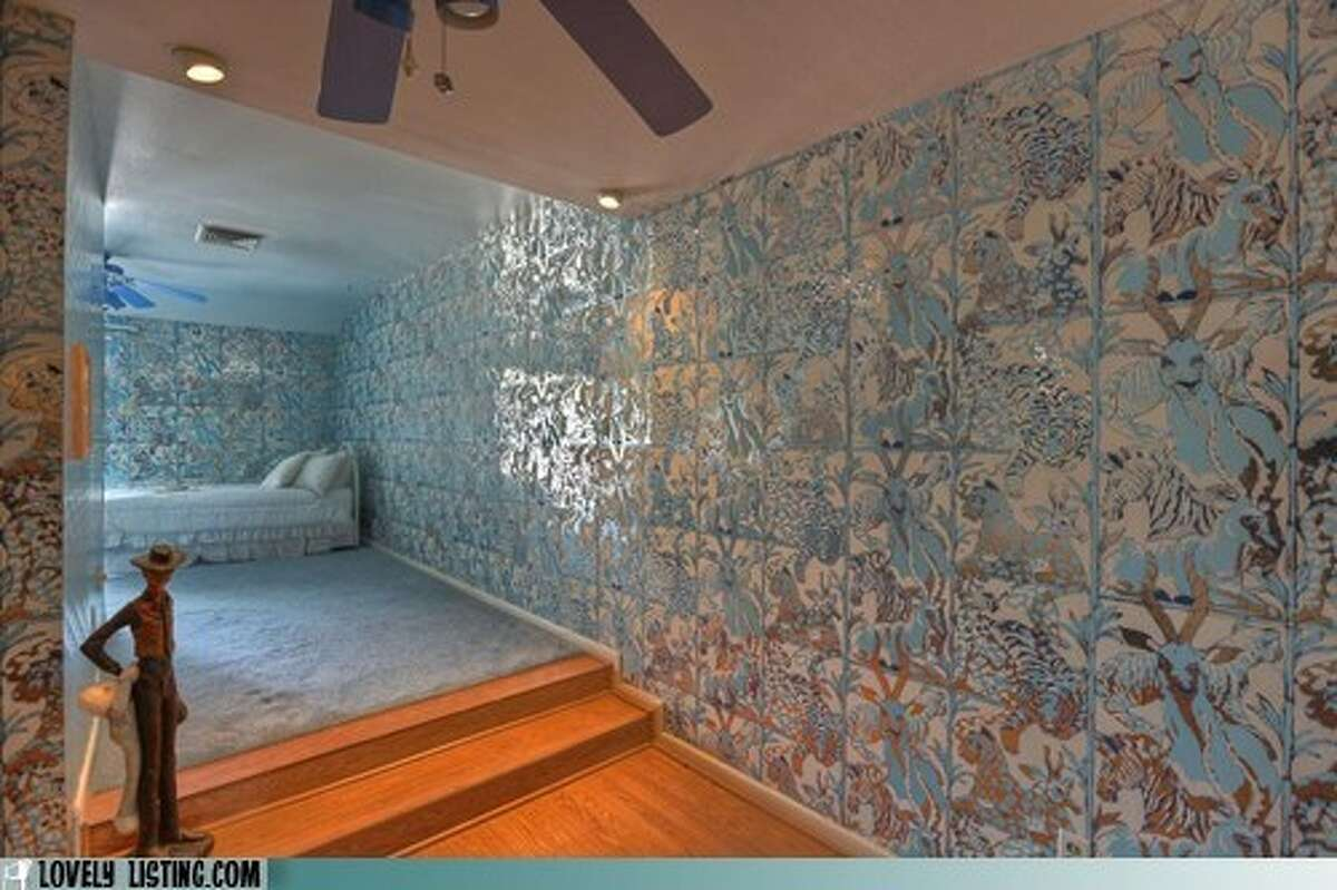 In the odd decor department is this odd bedroom textile, part jungle, part exploded Chinese silk factory. Photo: Lovely Listing.com