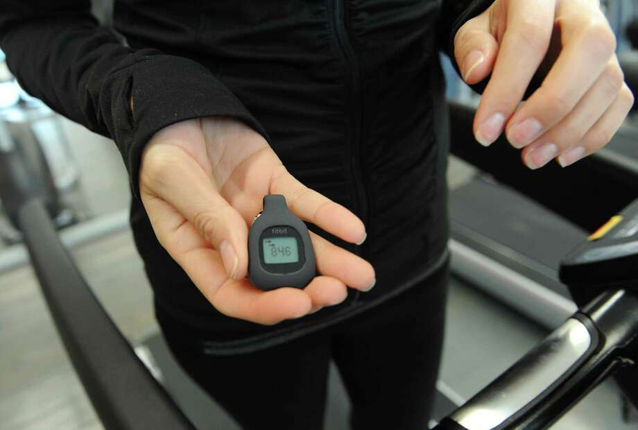 Old Greenwich resident Sarah Bamford shows the step count on her FitBit digital fitness tracker after running on the treadmill at CLAY Health Club and Spa in Port Chester, N.Y. Thursday, Jan. 22, 2015.  Bamford got a FitBit for Christmas, used it for a short time and lost interest and motivation to use it since then. Photo: Tyler Sizemore / Greenwich Time