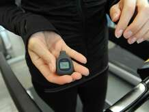 Old Greenwich resident Sarah Bamford shows the step count on her FitBit digital fitness tracker after running on the treadmill at CLAY Health Club and Spa in Port Chester, N.Y. Thursday, Jan. 22, 2015.  Bamford got a FitBit for Christmas, used it for a short time and lost interest and motivation to use it since then.