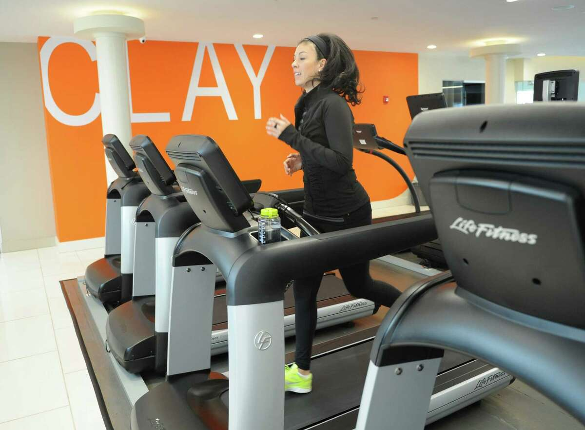 Old Greenwich resident Sarah Bamford runs on the treadmill at CLAY Health Club and Spa in Port Chester, N.Y. Thursday, Jan. 22, 2015. Bamford got a FitBit digital fitness tracker for Christmas, used it for a short time and lost interest and motivation to use it since then.