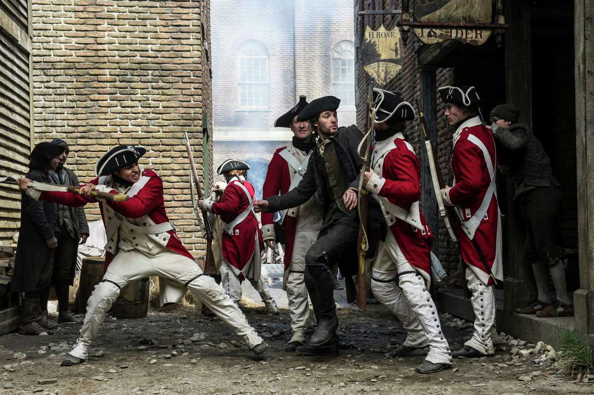 """Samuel Adams (played by British actor Ben Barnes) fights off redcoats in the History Channel miniseries """"Sons of Liberty."""""""
