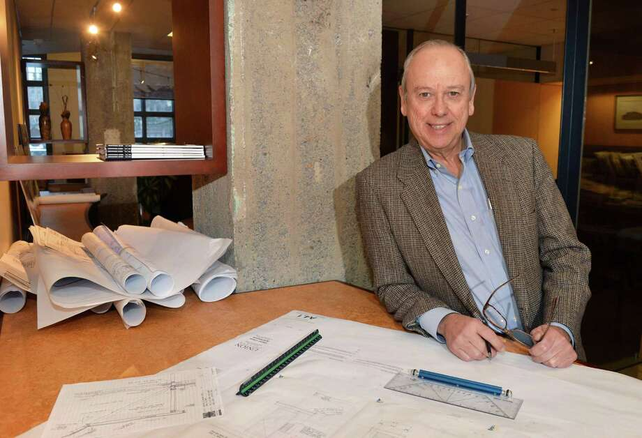 Architect Ted Malin with drawings in his office at Envision Architects Thursday Jan. 15, 2015, in Albany, NY.  (John Carl D'Annibale / Times Union) Photo: John Carl D'Annibale / 00030211A