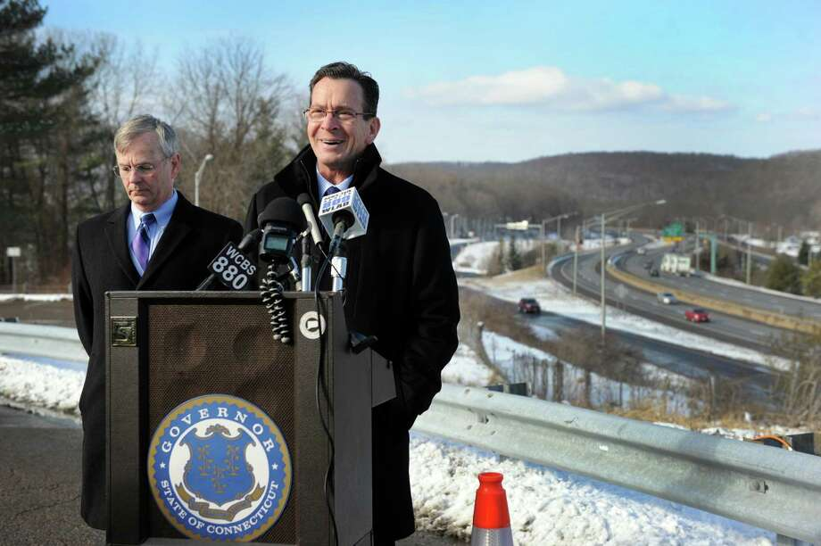 Gov. Dannel Malloy, right, and Department of Transportation Commissioner James P. Redeker address a news conference held at the I-84 West Exit 2 rest stop Thursday morning, January 22, 2015 in Danbury, Conn. The Danbury stop aimed to highlight the importance of upgrading the transportation infrastructure in the region and state. Photo: Carol Kaliff / The News-Times