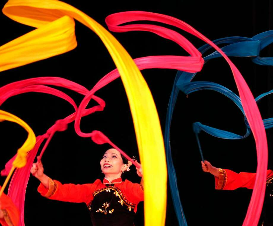 Chu-Ying Ku of the Nai-Ni Chen Dance Company of Fort Lee, NJ, performs the Ribbon Dance with other members of the troupe at Convent of the Sacred Heart in Greenwich, CT, Monday morning, March lst, 2010.  The school was celebrating the Chinese New Year. Photo: Bob Luckey / Greenwich Time