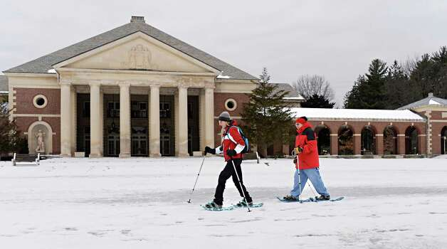 Long-time hiking partners and first-time snowshoers Deb Balcanoff of Latham and Andy Wexler of Glenville trek through Saratoga Spa State Park Thursday Jan. 22, 2015, in Saratoga Springs, NY.  (John Carl D'Annibale / Times Union) Photo: John Carl D'Annibale