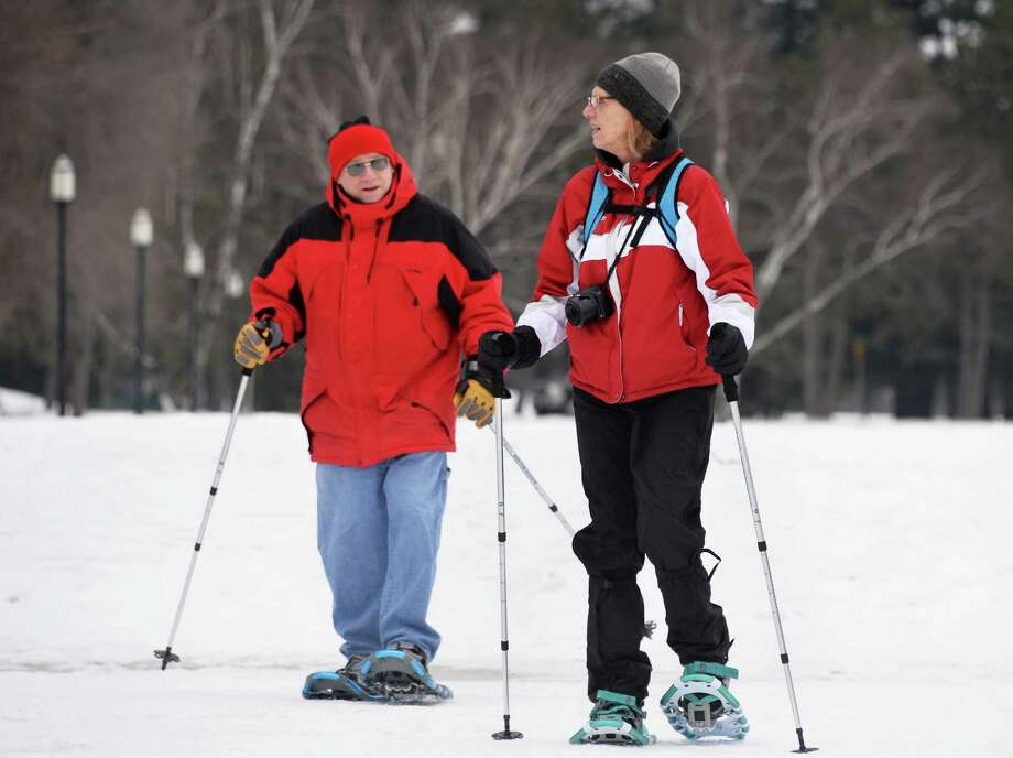 Long-time hiking partners and first-time snowshoers Andy Wexler of Glenville and Deb Balcanoff of Latham trek through Saratoga Spa State Park Thursday Jan. 22, 2015, in Saratoga Springs, NY.  (John Carl D'Annibale / Times Union) Photo: John Carl D'Annibale