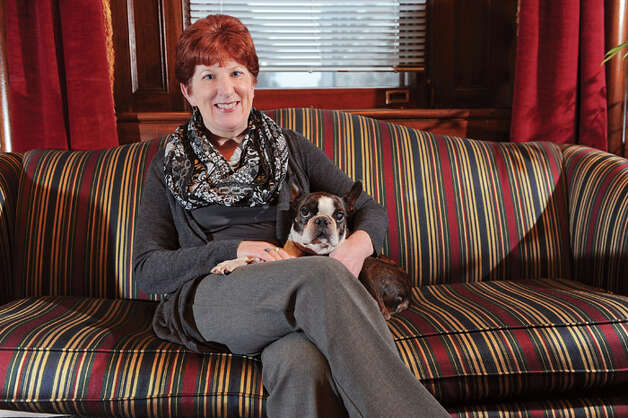 Mayor Kathy Sheehan and her Boston terrier, Ozzie, on Wednesday, Dec. 24, 2014, in the Mayor's office in Albany, N.Y. (Cindy Schultz / Times Union) Photo: Cindy Schultz, Compiled By 518Life / 00029963A