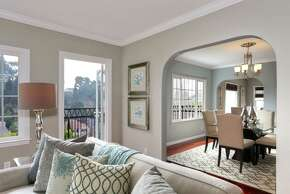An archway separates the living room from the dining room.