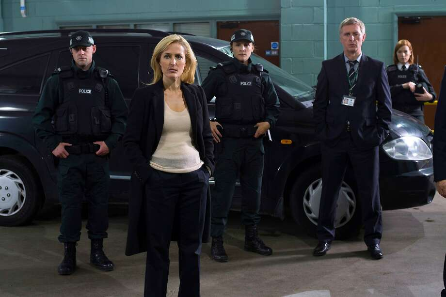"This image released by Netflix shows Gillian Anderson in the Netflix series ""The Fall.""  Anderson stars as a detective named Stella Gibson who hunts a serial killer, played by Jamie Dornan. (AP Photo/Netflix) Photo: Associated Press"