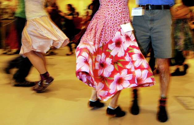 Couples dance a traditional contra dance during the Flurry on Saturday, Feb. 19, 2011, at Saratoga Springs City Center in Saratoga Springs, N.Y. (Cindy Schultz / Times Union) Photo: Cindy Schultz / 10012120A