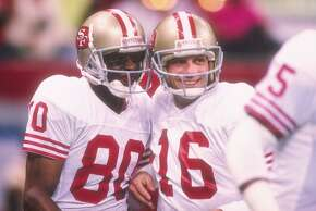 San Francisco 49ers quarterback Joe Montana (right) and wide receiver Jerry Rice celebrate during Super Bowl XXIV against the Denver Broncos at the Superdome in New Orleans, Louisiana. The 49ers won the game, 55-10.