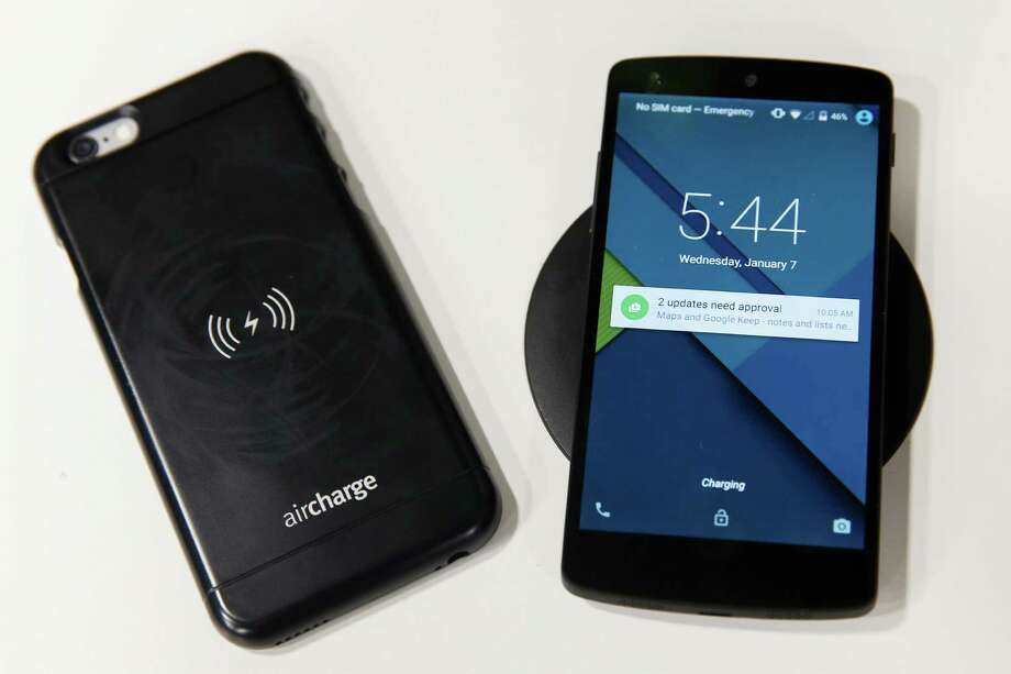 An iPhone 6 can get a boost from an Ergo Aircharge wireless charging case. Photo: Patrick T. Fallon / Bloomberg / © 2015 Bloomberg Finance LP