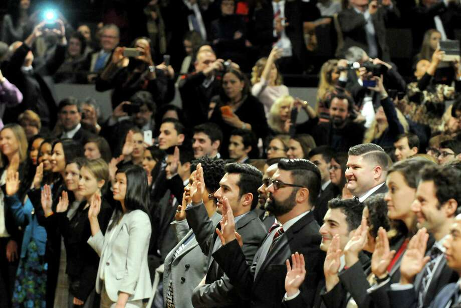 Newly admitted members of the New York State Bar are sworn in by the court at a ceremony at the Empire State Plaza Convention Center on Thursday Jan. 22, 2015 in Albany, N.Y. (Michael P. Farrell/Times Union) Photo: Michael P. Farrell / 00030281A